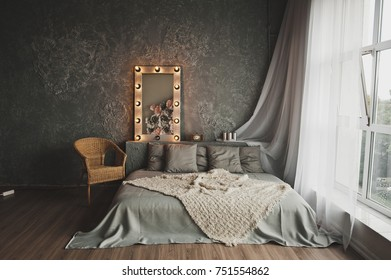 Studio decorated in the form of a bed near the window.