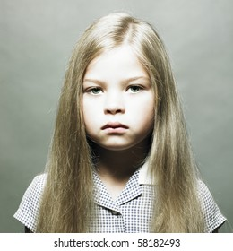 Studio fashion portrait of charming little girl