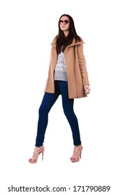 Studio fashion shot: beautiful girl in brown coat