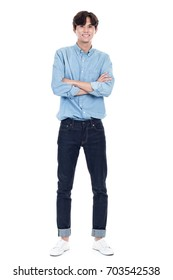 Studio full body portrait of a young asian man