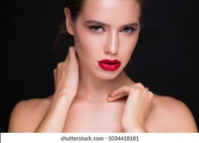 Studio glamorous portrait over black