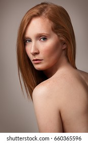 Studio headshot of beautiful ginger girl