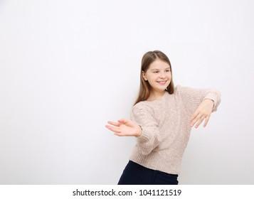 Studio image of lovely emotional caucasian teen girl