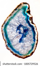 Studio image of  a slice of blue and white natural agate crystal