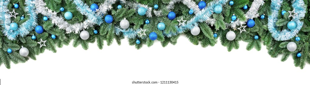 Studio isolated lush fir branches with baubles in blue and white, as a border or arch on pure white background