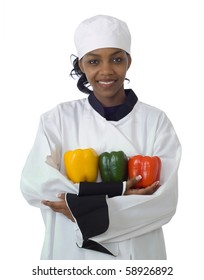 Studio isolated woman female chef with red and yellow peppers on white