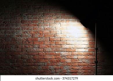 Studio light flash on brick wall background