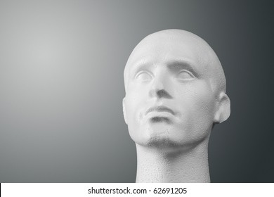 A studio lit white expanded polystyrene foam male head of generic design.  The file contains an accurate clipping path if you want a different background.