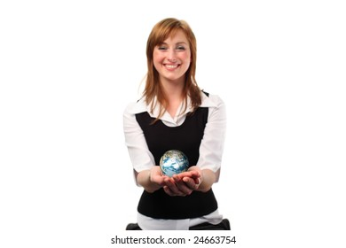 Studio lite shot of a business woman with a globe in her habd