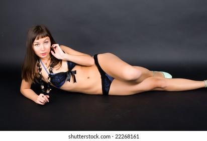 studio lying portrait of a brunette in underwear