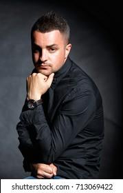 Studio male portrait on a dark background