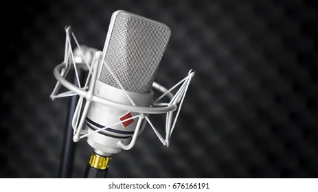 Studio Microphone with Acoustic Foam Tiles.  Shallow Depth of Field with focus on mic grill.