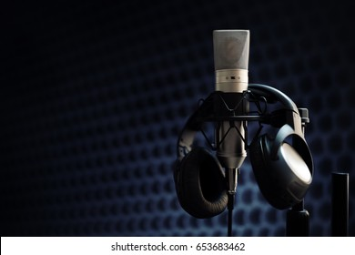 Studio microphone and headphones on mic stand against gray background