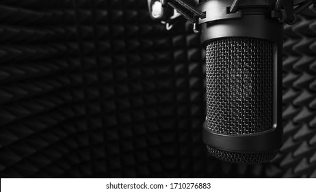 studio microphone surrounded by sound paneling foam