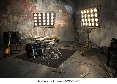Studio with musical instruments. Drums and guitars in the studio Musical instruments. Beautiful photo with musical instruments