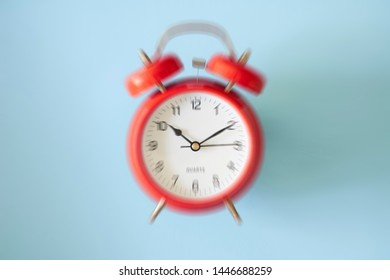 A studio photo of an alarm clock