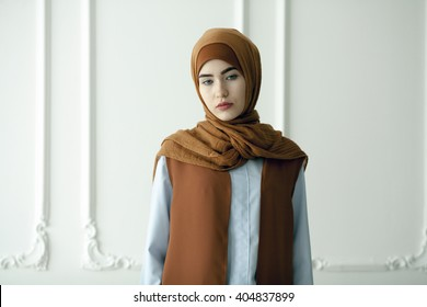 Studio photo of a beautiful young woman dressed oriental type in the Muslim style