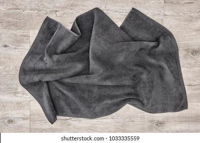 A studio photo of a black bathing towel
