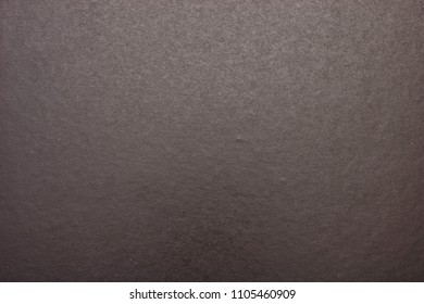 A studio photo of a black cardboard background