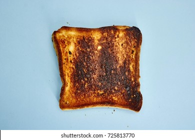 A studio photo of burnt toast