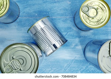 A studio photo of canned food