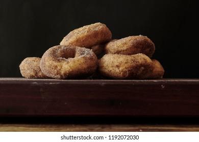 A studio photo of cinnamon donuts