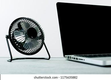 A studio photo of a desk fan
