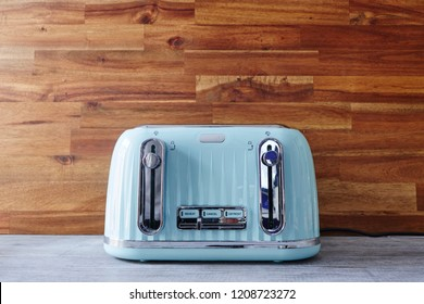 A studio photo of an electric toaster