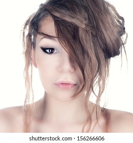 Studio photo of a girl with matted hair.