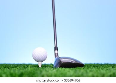 A studio photo of golfing equipment on artificial grass