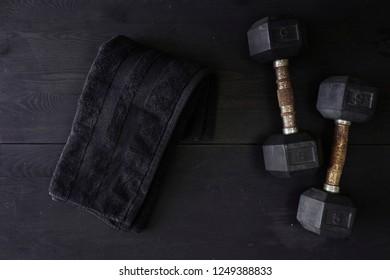 A studio photo of gym dumbells