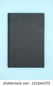 A studio photo of a hard cover book