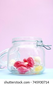 A studio photo of a jar of lollies