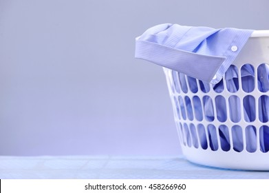 A studio photo of a laundry washing basket
