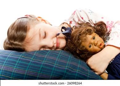 studio photo of little girl in bed