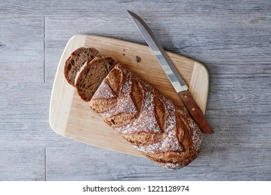 A studio photo of a loaf of Bread