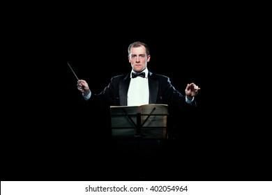 Studio photo of music conductor holding his baton