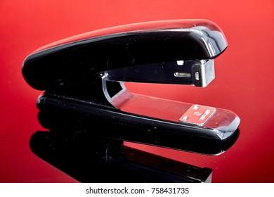 A studio photo of an office stapler