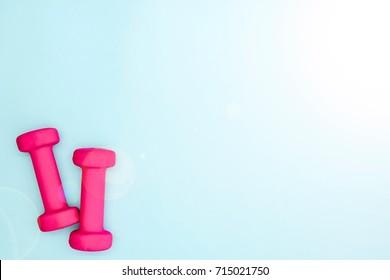 A studio photo of pink dumbells