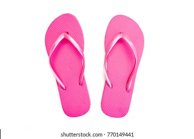 A studio photo of pink flip flops