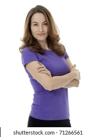 Studio photo of pretty brunette woman standing with arms crossed on white background.