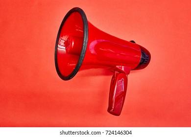 A studio photo of a red mega phone