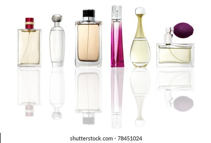 Studio photo of set of luxury perfume bottles. Isolated on white background