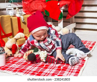 Studio photo shoot First Christmas of a liittle handsome enjoying boy