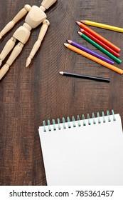 A studio photo of a sketch pad