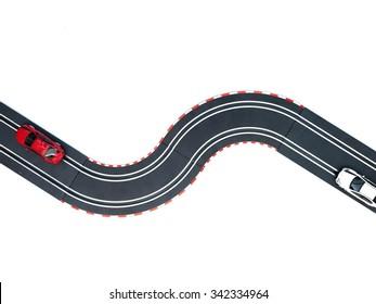 A studio photo of a slot car race set