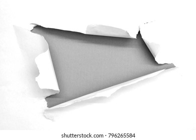 A studio photo of torn paper