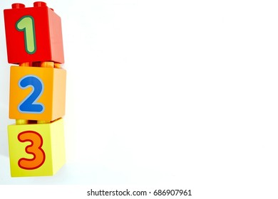 A studio photo of toy block number