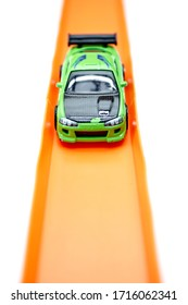 A studio photo of a toy cars