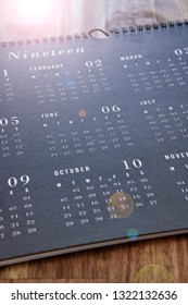 A studio photo of a wall calendar